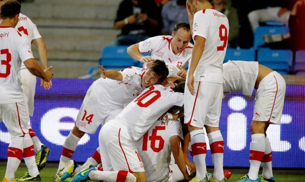 Switzerland's players celebrate after taking a 2-0 lead against Norway in their 2014 World Cup qualifying soccer match in Ullevaal stadium, Oslo, Sept. 10, 2013. (AP Photo/Scanpix Norway, Hakon Mosvold Larsen) NORWAY OUT
