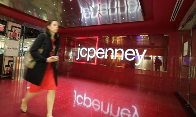 FILE - In this April 9, 2013 file photo, a customer leaves a JC Penney store in New York. JC Penney reports quarterly financial results after the market closes on Thursday, May 15, 2014. (AP Photo/Mark Lennihan, File)