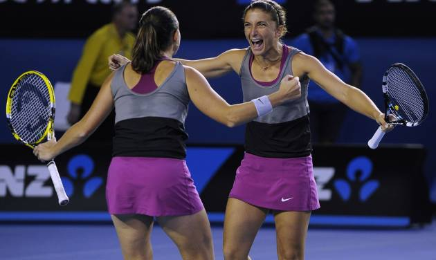 Italy's Sara Errani, right, and Roberta Vinci, left, celebrate after defeating Russia's Ekaterina Makarova and Elena Vesnina in their women's doubles final at the Australian Open tennis championship in Melbourne, Australia, Friday, Jan. 24, 2014.(AP Photo/Andrew Brownbill)