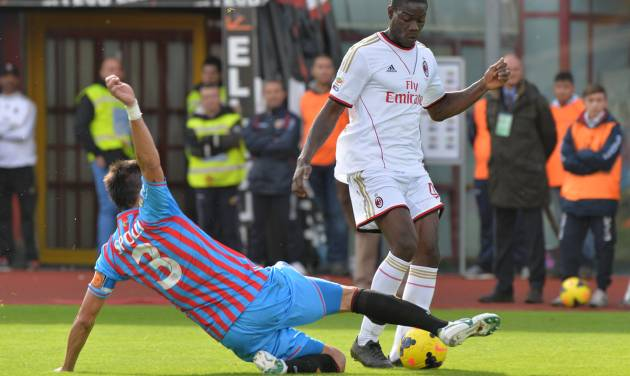 AC Milan forward Mario Balotelli, right, is tackled by Catania defender Nicolas Spolli, of Argentina, during the Serie A soccer match between Catania and AC Milan at the Angelo Massimino stadium in Catania, Italy, Sunday, Dec. 1, 2013. (AP Photo/Carmelo Imbesi)