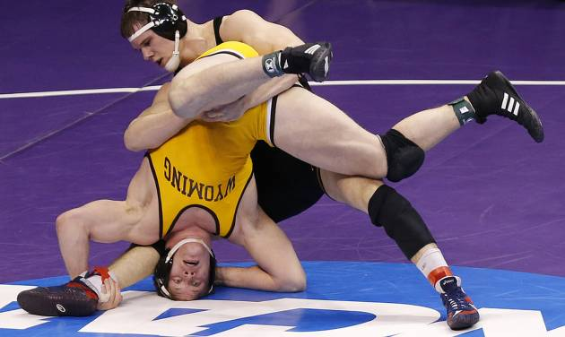 Wyoming's Shane Woods takes on Iowa's Nathan Burak in the 197 pound match during the 2014 NCAA Div. 1 Wrestling Championships at Chesapeake Energy Arena in Oklahoma City, Okla. on Thursday, March 20, 2014. Photo by Chris Landsberger, The Oklahoman