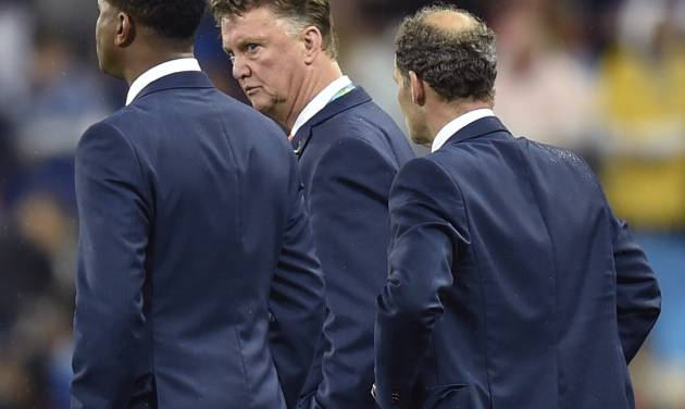 Netherlands' head coach Louis van Gaal reacts after a shootout at the end of the World Cup semifinal soccer match between the Netherlands and Argentina at the Itaquerao Stadium in Sao Paulo Brazil, Wednesday, July 9, 2014. Argentina won 4-2 on penalties after the match ended 0-0 after extra time.  (AP Photo/Martin Meissner)