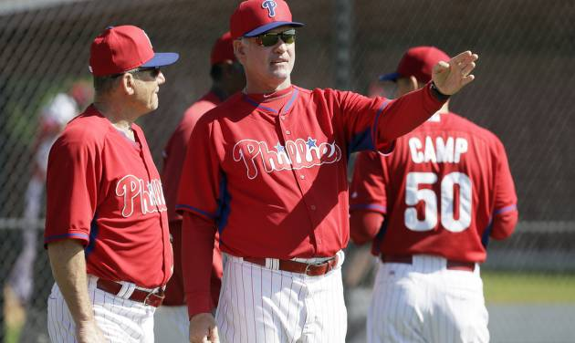 Philadelphia Phillies manager Ryne Sandberg talks with bench coach Larry Bowa, left, during spring training baseball practice Wednesday, Feb. 19, 2014, in Clearwater, Fla. (AP Photo/Charlie Neibergall)