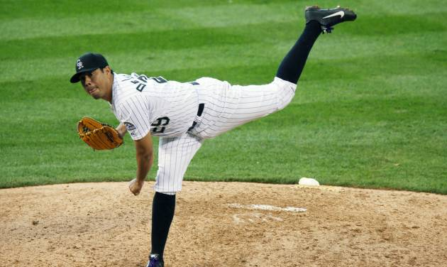 Colorado Rockies starting pitcher Jorge De La Rosa works against the Washington Nationals in the eighth inning of the Rockies' 6-4 victory in a baseball game in Denver on Wednesday, July 23, 2014. (AP Photo)