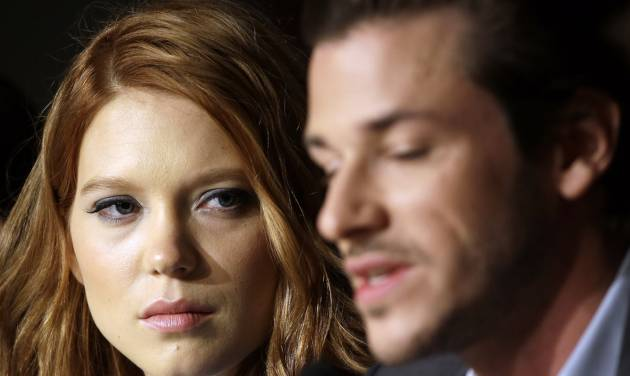 Actress Lea Seydoux, left, listens to actor Gaspard Ulliel speak during a press conference for Saint-Laurent at the 67th international film festival, Cannes, southern France, Saturday, May 17, 2014. (AP Photo/Thibault Camus)