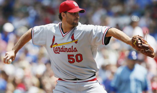 St. Louis Cardinals starting pitcher Adam Wainwright delivers against the Chicago Cubs during the first inning of a baseball game on Sunday, July 27, 2014, in Chicago. (AP Photo/Andrew A. Nelles)