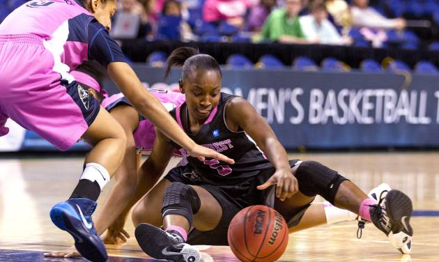 Wake Forest's Chelsea Douglas, right,  tries to control the loose ball between her legs as Pittsburgh's Brianna Kiesel reaches in during the 2014 ACC Women's Basketball Tournament at the Greensboro Coliseum, on Wednesday, March 5, 2014, in Greensboro, N.C. (AP Photo/News & Record, Joseph Rodriguez)