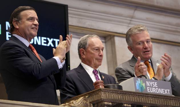New York City Mayor Michael Bloomberg, center, gives a thumbs up after ringing in the opening bell at the New York Stock Exchange in New York, Wednesday, Oct. 31, 2012. Traffic is snarled, subways out of commission, streets flooded and power out in many parts of the city, but the New York Stock Exchange opened without hitch Wednesday after an historic two-day shutdown, courtesy of Superstrom Sandy. (AP Photo/Seth Wenig)