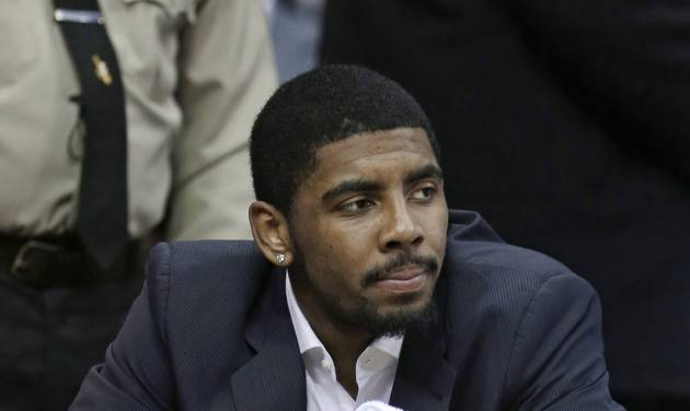 Cleveland Cavaliers' Kyrie Irving watches from the bench during the first quarter of an NBA basketball game against the Toronto Raptors on Wednesday, Feb. 27, 2013, in Cleveland. (AP Photo/Tony Dejak)