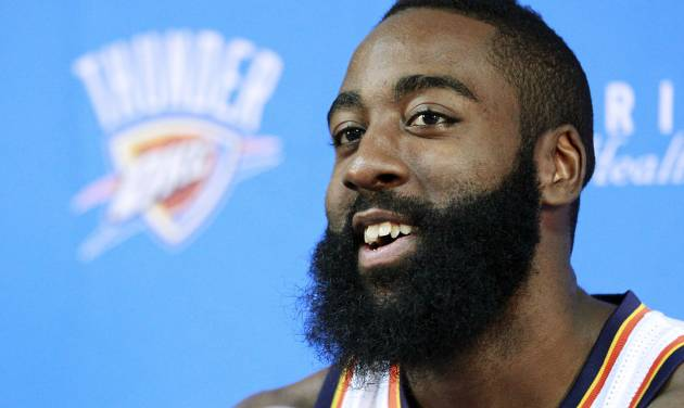 Oklahoma City Thunder's James Harden smiles as he answers a question during their NBA basketball media day in Oklahoma City, Monday, Oct. 1, 2012. The Sixth Man of the Year is holding out hope that he'll reach terms on a contract extension with the Thunder by the end of the month. (AP Photo/Sue Ogrocki)