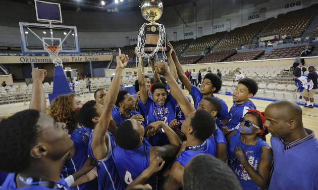 Millwood celebrates with the gold ball trophy after the win over Okemah during the state high school basketball tournament Class 3A boys championship game between Millwood High School and Okemah High School at the State Fair Arena on Saturday, March 9, 2013, in Oklahoma City, Okla. Photo by Chris Landsberger, The Oklahoman