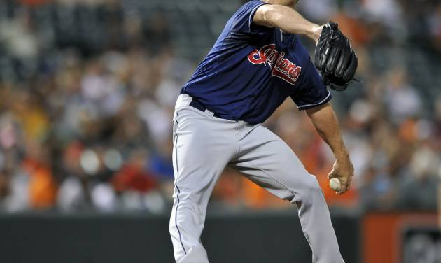 Cleveland Indians pitcher Scott Kazmir delivers against the Baltimore Orioles in the third inning of a baseball game Wednesday, June 26, 2013 in Baltimore. (AP Photo/Gail Burton)