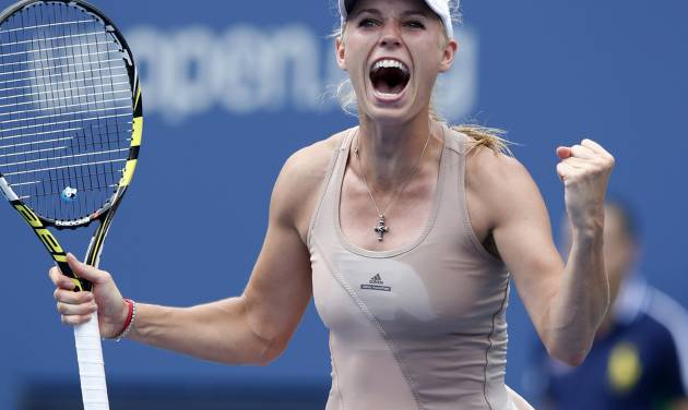 Caroline Wozniacki, of Denmark, reacts after defeating Maria Sharapova, of Russia, during the fourth round of the 2014 U.S. Open tennis tournament, Sunday, Aug. 31, 2014, in New York. (AP Photo/Kathy Willens)