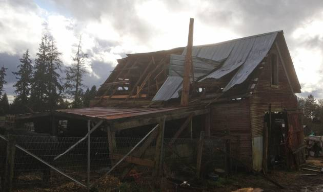 This image provided by the Clark Co. Fire District shows the wind damage to a barn in Hockinson, Wash., Thursday March 21, 2013. Thursday's weather in Washington state featured enough snow to close the main east-west route across the Cascade Mountains and a barn-busting tornado in the southwest part of the state. The National Weather Service office in Portland, Ore., confirms a weak tornado packing winds of 65 to 85 mph ripped apart a barn in Hockinson, Wash., near Vancouver. No one was hurt. (AP Photo/Clark Co. Fire District)