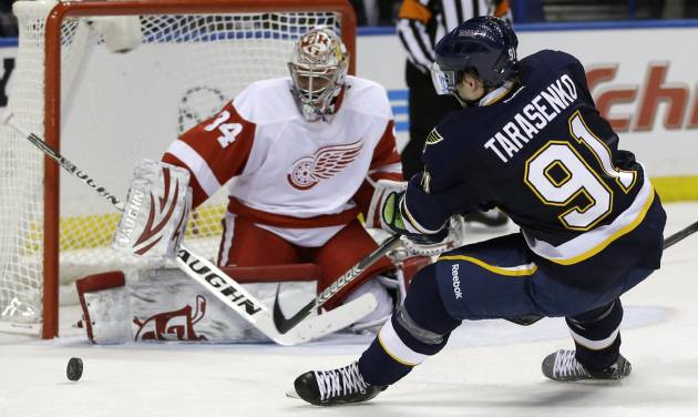 St. Louis Blues' Vladimir Tarasenko, of Russia, shoots just wide of Detroit Red Wings goalie Petr Mrazek, left, of the Czech Republic, during the second period of an NHL hockey game Thursday, Feb. 7, 2013, in St. Louis. (AP Photo/Jeff Roberson)