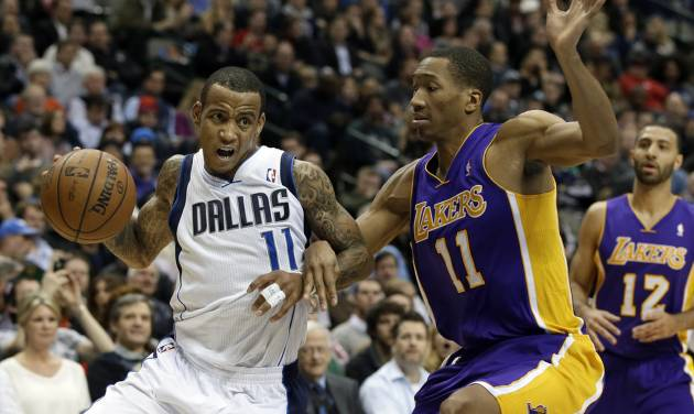 Dallas Mavericks' Monta Ellis (11) attempts to get to the basket as Los Angeles Lakers' Wesley Johnson (11) defends in the second half of an NBA basketball game, Tuesday, Jan. 7, 2014, in Dallas. The Mavericks won 110-97. (AP Photo/Tony Gutierrez)