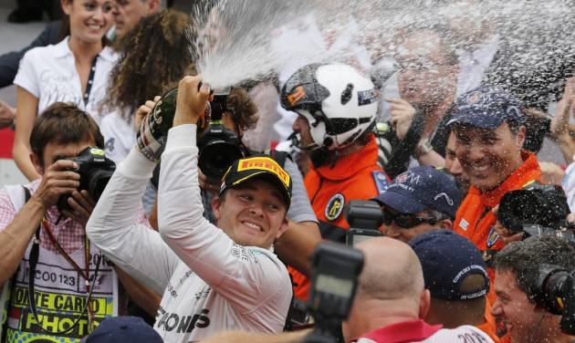 Mercedes driver Nico Rosberg of Germany sprays champagne after winning the Monaco Formula One Grand Prix, at the Monaco racetrack, in Monaco, Sunday, May 25, 2014.  Nico Rosberg won the Monaco Grand Prix from pole position on Sunday to take the overall championship lead from his teammate Lewis Hamilton, who finished second to give Mercedes a fifth straight 1-2 finish. The German driver clinched his second victory of the season and fifth of his career, making a strong start and holding off Hamilton to repeat his maiden GP win from pole here in Monaco last year. (AP Photo/Luca Bruno)