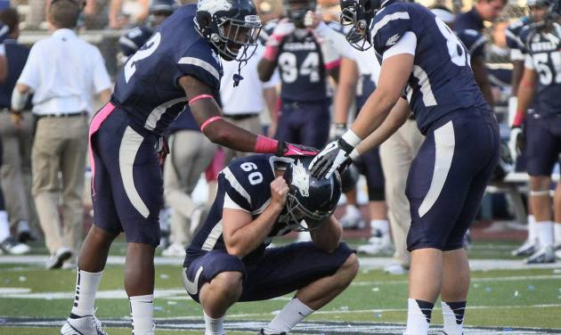 Nevada's Allen Hardison(60) is comforted by teammates after missing a field goal against Wyoming during the second half of an NCAA college football game in Reno, Nev., on Saturday, Oct. 6, 2012. (AP Photo/Cathleen Allison)