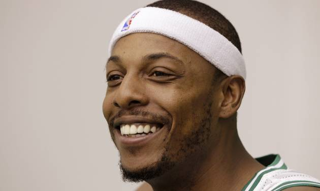 Boston Celtic forward Paul Pierce smiles as he answers reporter's questions during media day at the NBA basketball team's training center in Waltham, Friday, Sept. 28, 2012. (AP Photo/Stephan Savoia)