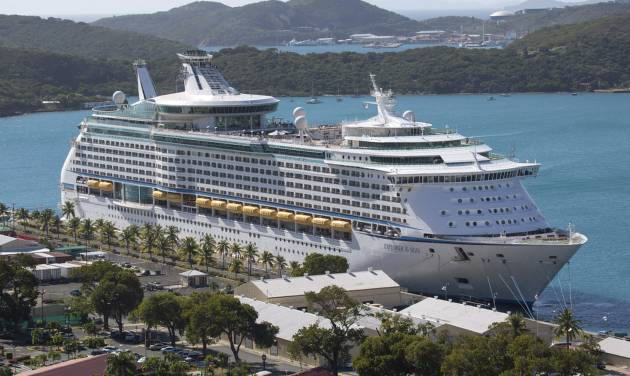 The Royal Caribbean International's Explorer of the Seas is docked at Charlotte Amalie Harbor in St. Thomas, U. S. Virgin Islands, Sunday, Jan. 26, 2014. U.S. health officials have boarded the cruise liner to investigate an illness outbreak that has stricken at least 300 people with gastrointestinal symptoms including vomiting and diarrhea. (AP Photo/Thomas Layer)