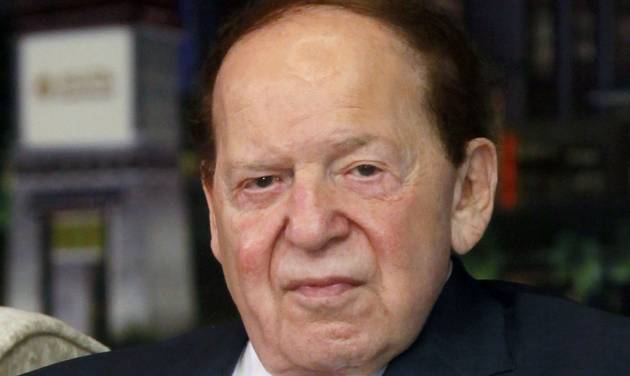 """FILE - In this April 12, 2012 file photo, Las Vegas Sands Chairman and CEO Sheldon Adelson speaks at a news conference for the Sands Cotai Central in Macau. Casino giant Las Vegas Sands Corp. picked Madrid over Barcelona for a multi-billion dollar Spainish gambling resort project dubbed """"EuroVegas."""" The Spanish capital, the country's largest city, emerged as the company's best choice for the development, Las Vegas Sands Chairman and CEO Sheldon Adelson said in a statement released late Friday, Sept. 7, 2012 in Las Vegas. (AP Photo/Kin Cheung, File)"""