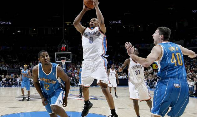 Oklahoma City's Russell Westbrook grabs a rebound between Hilton Armstrong, left,  and Ryan Bowen of New Orleans during the NBA basketball game between the Oklahoma City Thunder and the New Orleans Hornets at the Ford Center in Oklahoma City on Friday, Nov. 21, 2008.   BY BRYAN TERRY, THE OKLAHOMAN