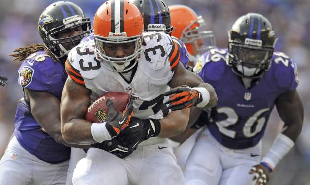 In this Sunday, Sept. 15, 2013, photo, Cleveland Browns running back Trent Richardson carries the ball during an NFL football game against the Baltimore Ravens in Baltimore. The Browns have traded Richardson to the Indianapolis Colts in a surprise move less than two years after drafting him in the first round. The Browns (0-2), struggling on offense under new coach Rob Chudzinski, announced the move Wednesday afternoon, Sept. 18. They will also bring in veteran running back Willis McGahee for a physical. (AP Photo/Gail Burton)