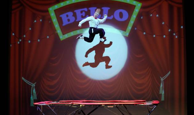 """This March 23, 2013 photo shows performer Bello Nock jumping on a trampoline as he performs during his """"Bello Mania"""" show at the New Victory Theater in New York. Nock, a seventh-generation circus performer, is never offstage during the 90-minute performance, which combines slapstick clowning with death-defying aerial stunts. He performs through March 31 at the New Victory before moving on to the Canadian side of Niagara Falls and then a 10-week stint at the Beau Rivage Casino in Biloxi, Miss.   (AP Photo/Richard Drew)"""