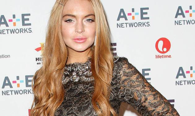 "In this May 9, 2012 photo shows actress Lindsay Lohan at the A&E Networks 2012 Upfront at Lincoln Center in New York. Prosecutors are not moving forward with charges against Lohan after she was accused of clipping a man with her car outside a New York nightclub. The ""Mean Girls"" star had been due to make her first court appearance in the case on Tuesday, Oct. 23, but the Manhattan district attorney's office says there now is no court date scheduled at any point. (AP Photo/Starpix, Kristina Bumphrey, file)"