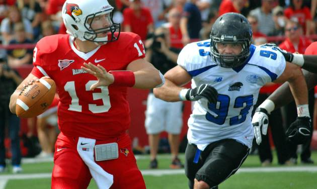 Illinois State quarterback Matt Brown (13) is chased by Eastern Illinois' Pat Wertz (93) during the first half of an NCAA college football game at Hancock Stadium in Normal, Ill., Saturday Sept. 15, 2012. Wertz caused Brown to fumble the ball that was recovered by Illinois State's Pete Cary. (AP Photo/The Pantagraph, Steve Smedley)