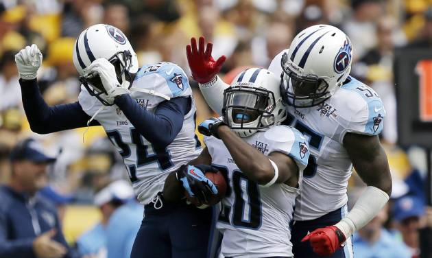 Tennessee Titans cornerback Alterraun Verner (20) celebrates with teammates Coty Sensabaugh (24) and Zach Brown (55) after intercepting a pass by Pittsburgh Steelers quarterback Ben Roethlisberger (7) during the second quarter of an NFL football game in Pittsburgh, Sunday, Sept. 8, 2013. The Titans won 16-9. (AP Photo/Gene J. Puskar)