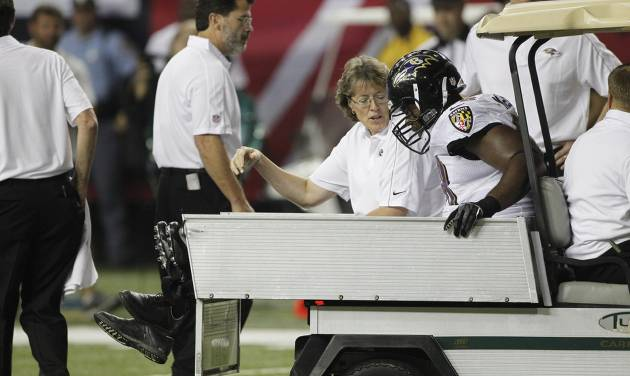 Baltimore Ravens defensive end Ryan McBean (98) heads off the field after an injury during the first half of an NFL preseason football game against the Atlanta Falcons Thursday, Aug. 9, 2012, in Atlanta. (AP Photo/John Bazemore)