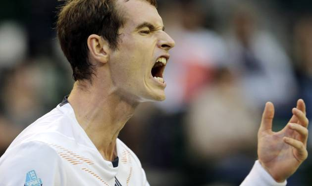 Andy Murray of Britain reacts after missing return to Ivo Karlovic of Croatia during their first round match of the Japan Open tennis championships in Tokyo, Tuesday, Oct. 2, 2012. (AP Photo/Koji Sasahara)