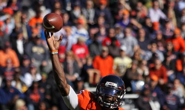 Virginia quarterback David Watford (5) throws a pass down field against Georgia Tech in the second half  of an NCAA college football game Saturday, Oct. 26, 2013, at Scott Stadium in Charlottesville, Va. (AP Photo/The Daily Progress, Ryan M. Kelly)