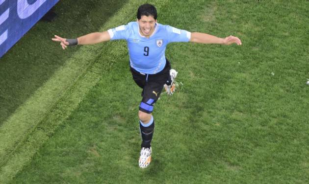 Uruguay's Luis Suarez celebrates scoring his side's second goal during the group D World Cup soccer match between Uruguay and England at the Itaquerao Stadium in Sao Paulo, Brazil, Thursday, June 19, 2014.  (AP Photo/Francois Xavier Marit, pool)