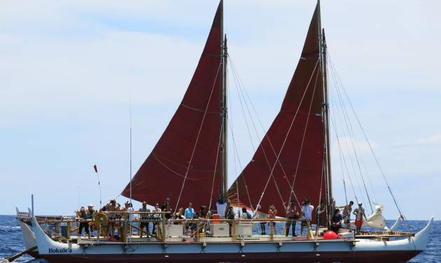 The Hokulea sailing canoe is seen off Honolulu on Tuesday, April 29, 2014. The Polynesian voyaging canoe is setting off on a 3-year voyage around the world, navigating using no modern instrumentation. (AP Photo/Sam Eifling)