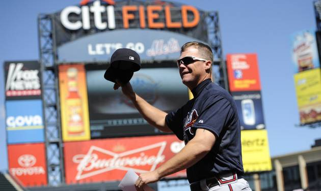 Atlanta Braves third baseman Chipper Jones waves his hat to the cheers of fans as he runs back to the dugout after bringing the lineup card to the umpires before a baseball game against the New York Mets, Sunday, Sept. 9, 2012, at Citi Field in New York. Jones is retiring after the season and it was his last game at Citi Field. (AP Photo/Kathy Kmonicek)