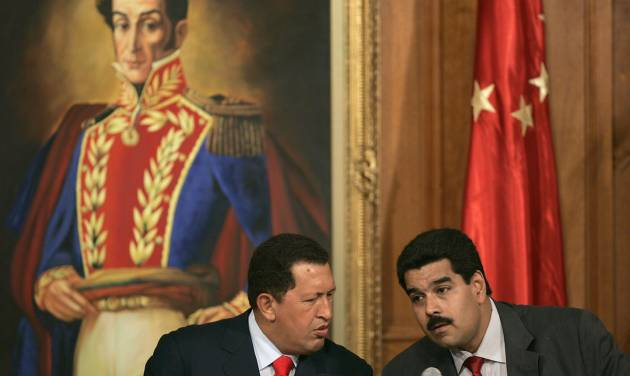 "FILE .- In this Oct. 17, 2006 file photo Venezuelan President Hugo Chavez, left, talks with his then Foreign Minister and current Vice-President Nicolas Maduro during a meeting with Chinese businessmen at Miraflores Palace in Caracas, Venezuela.  Chavez is to return to Cuba Sunday for another surgery in his battle against cancer, which has led him to speak publicly of a successor for the first time.  Chavez said Saturday that if there are ""circumstances that prevent me from exercising the presidency further""  Vice-President Nicolas Maduro should replace him for the remainder of his term. (AP Photo/Fernando Llano, File)"