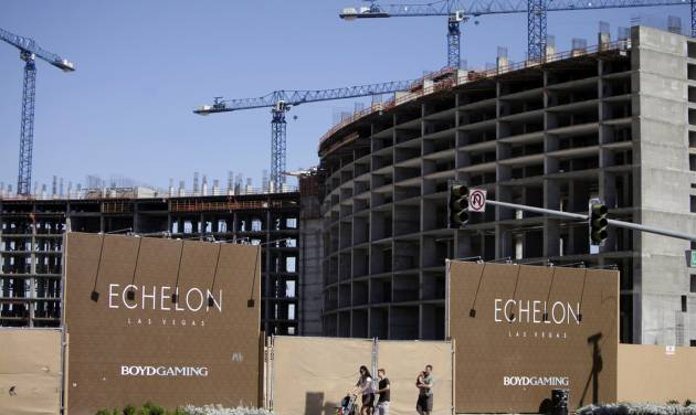 FILE - This May, 2009 file photo shows people walking past the construction site of Boyd Gaming's Echelon project in Las Vegas.  In a Wednesday, May 7, 2014 licensing hearing before gambling regulators, Malaysian conglomerate Genting Group unveiled new details about its planned Resorts World development at the less-trafficked north end of the Strip. (AP Photo/Jae C. Hong, File)