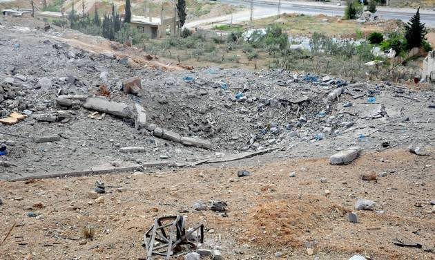 This photo released by the Syrian official news agency SANA, shows a general view of damaged buildings wrecked by an Israeli airstrike, in Damascus, Syria, Sunday, May 5, 2013. Israeli warplanes struck areas in and around the Syrian capital early Sunday, setting off a series of explosions as they targeted a shipment of highly accurate, Iranian-made guided missiles believed to be on their way to Lebanon's Hezbollah militant group, officials and activists said. The attack, the second in three days, signaled a sharp escalation of Israel's involvement in Syria's bloody civil war. Syria's state media reported that Israeli missiles struck a military and scientific research center near the Syrian capital and caused casualties. (AP Photo/SANA)