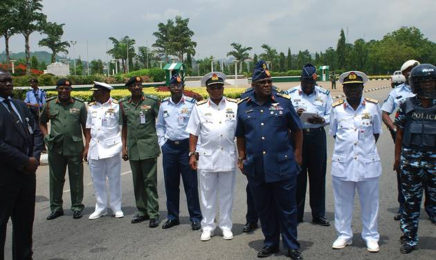 """Nigeria's chief of defense staff Air Marshal Alex S. Badeh, front, and other army chiefs wait to address the Nigerians Against Terrorism group during a demonstration calling on the government to rescue the kidnapped girls of the government secondary school in Chibok, in Abuja, Nigeria, Monday, May 26, 2014. Scores of protesters chanting """"Bring Back Our Girls"""" marched in the Nigerian capital Monday to protest the abductions of more than 300 schoolgirls by Boko Haram, the government's failure to rescue them and the killings of scores of teachers by Islamic extremists in recent years. (AP Photo/Gbenga Olamikan)"""