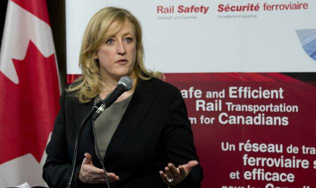 Transport Minister Lisa Raitt announces new railway safety measures during a news conference on Wednesday, April 23, 2014 in Ottawa, Ontario.  Raitt announced that the DOT-111 tankers, which are used to carry crude oil and ethanol and are prone to rupture, must be retired or retrofitted within three years. (AP Photo/The Canadian Press, Adrian Wyld)