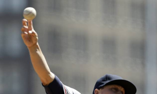 Atlanta Braves starting pitcher Kris Medlen (54) delivers in the first inning of a baseball game against the Pittsburgh Pirates  in Pittsburgh Sunday, April 21, 2013. (AP Photo/Gene J. Puskar)