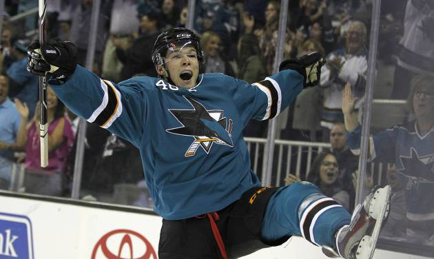 San Jose Sharks center Tomas Hertl celebrates after scoring a goal against Phoenix Coyotes during the first period an NHL hockey game in San Jose, Calif., Saturday, Oct. 5, 2013. (AP Photo/Tony Avelar)
