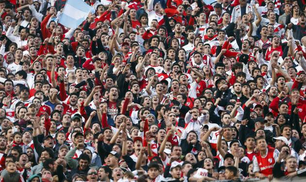 River Plate's fans cheer for their team during an Argentine league soccer match against Quilmes in Buenos Aires, Argentina, Sunday, May 18, 2014. (AP Photo/Victor R. Caivano)