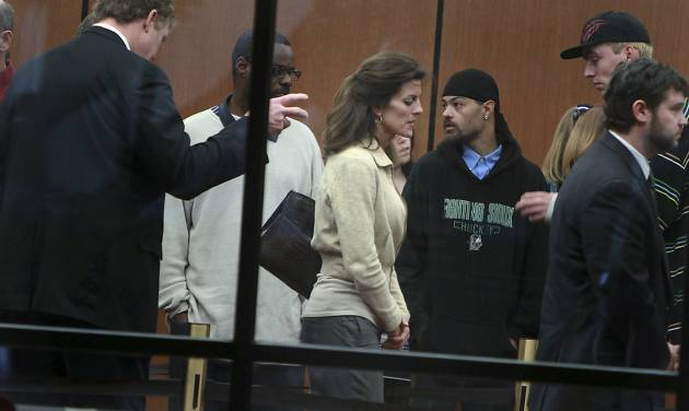 Amy Senser, center, arrives at the Hennepin County Government center for her trial Tuesday, May 1, 2012, in Minneapolis. Senser, 45, of Edina, Minn., is charged with three felony counts of criminal vehicular homicide plus a misdemeanor count of careless driving stemming from the Aug. 23 death of Anousone Phanthavong, who was struck and killed on a freeway exit ramp. (AP Photo/Star Tribune, Elizabeth Flores) ST. PAUL OUT MINNEAPOLIS-AREA TV OUT MAGS OUT