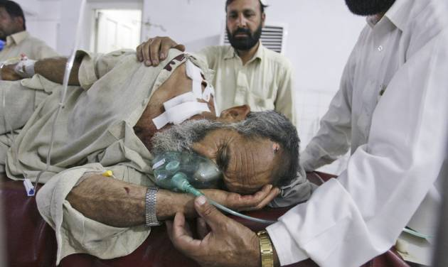 A man who was injured in a suicide bombing in the tribal region of Khar in Bajur, is comforted by relatives, in a hospital in Peshawar, Pakistan, Friday, May 4, 2012. A suicide bombing in a Pakistani market close to the Afghan border killed 20 people Friday, officials said, a day after the U.S. released letters seized from Osama bin Laden's compound that criticized Pakistani militants for killing too many civilians. (AP Photo/Mohammad Sajjad)