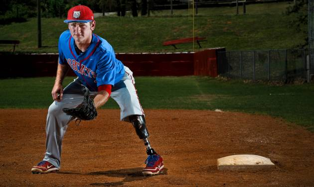 Binger-Oney High School senior first baseman DeKota Green poses for a photo at first base showing his prosthetic leg on Monday, May 5, 2014 in Binger, Okla.  Green had to have his left leg removed after an ATV accident.      Photo by Chris Landsberger, The Oklahoman