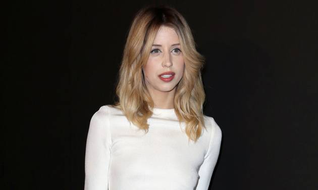 FILE - In this Tuesday, Feb. 25, 2014 file photo, Peaches Geldof arrives to attend the ETAM's ready to wear fall/winter 2014-2015 fashion collection presented in Paris. A British coroner has concluded that model and TV personality Peaches Geldof died from a heroin overdose. Coroner Roger Hatch said Wednesday that Geldof had taken a fatal dose after a period of trying to come off the drug. The 25-year-old daughter of Live Aid organizer Bob Geldof was found dead at her home south of London on April 7, 2014. (AP Photo/C. d'Ettorre, File)