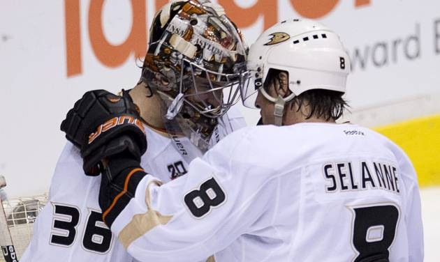 Anaheim Ducks Teemu Selanne (8) speaks with Anaheim Ducks goalie John Gibson (36) following their 3-0 win over the Vancouver Canucks in Vancouver, Monday, April 7, 2014. (AP Photo/The Canadian Press, Jonathan Hayward)